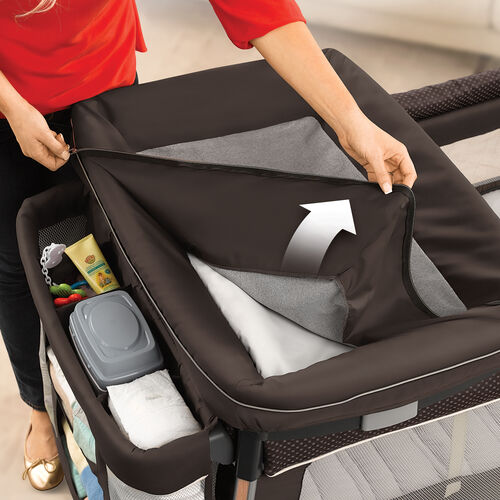 The changer features a zip-off cover for easy cleaning