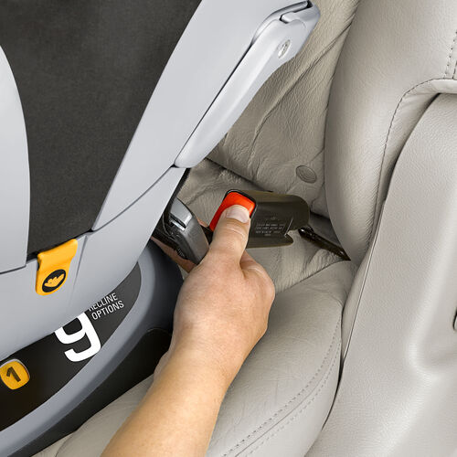 Install the NextFit Convertible Car Seat Gravity with the LATCH connector straps as shown or with the vehicle seat belt