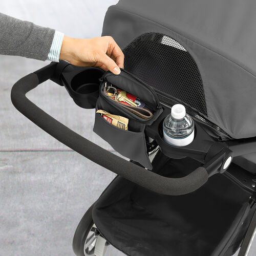 The parent tray on the Bravo LE Stroller contains a cup holder and zippered fabric storage compartment