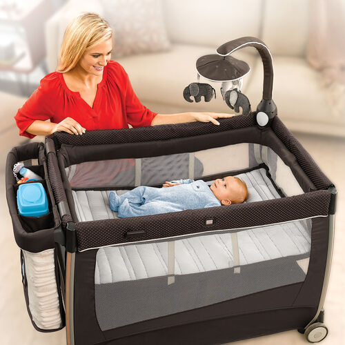The easy to install bassinet with electronic toy bar includes detachable soft toys