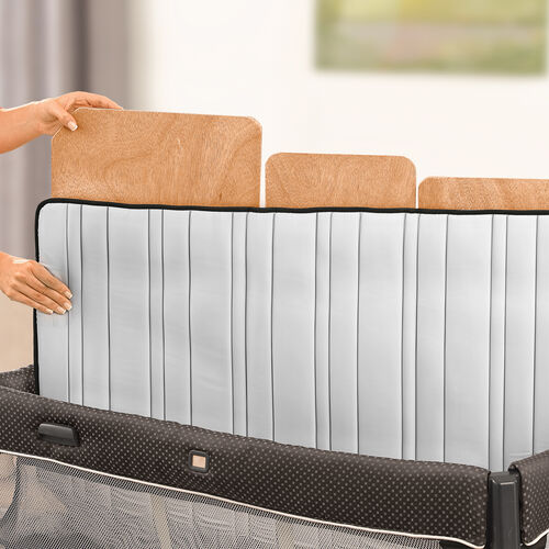 Machine wash the mattress of the Chicco Lullaby Dream playard with removable floor board and zip off quilted matress