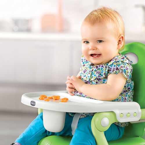 Baby enjoying a meal with the Pocket Snack Booster Seat and Tray