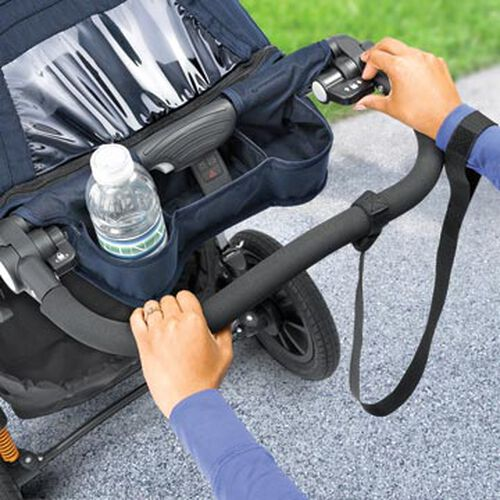 Hand-operated parking break on the Activ3 Jogging Stroller ensures foot pedals don't interfere with your run