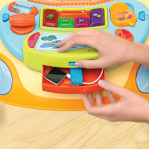 Plug in your iPod or phone to play your own music for baby! Locking storage compartment in the Chicco Dance Baby Walker keeps your electronics safe
