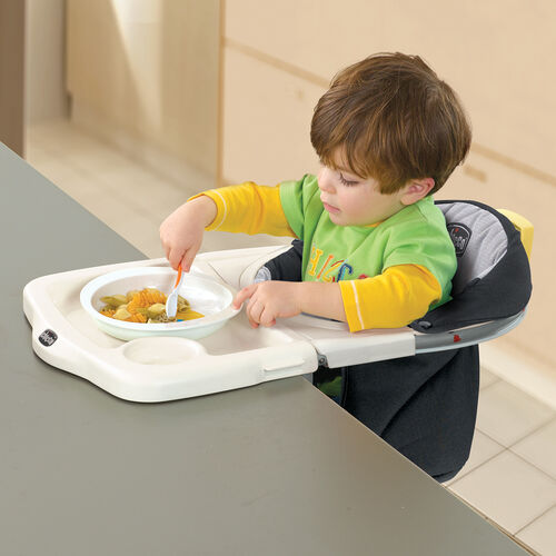 Babies can face inward in the Chicco 360 Hook On High Chair to enjoy a meal with the rest of the family at the table
