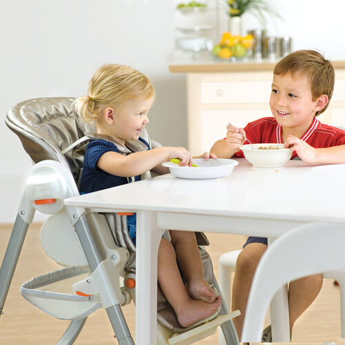 The Polly Magic Highchair's armrests can fold down to get older kids up close to the table